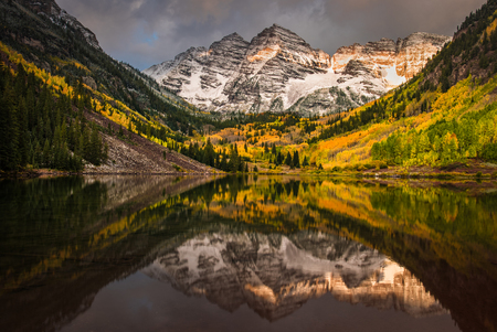 First morning light touching Rockie mountain at Maroon bell, Maroon lake, Aspen, Colorado