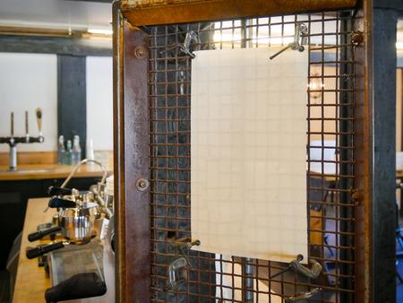 Blank paper on meatal board in Coffee shop