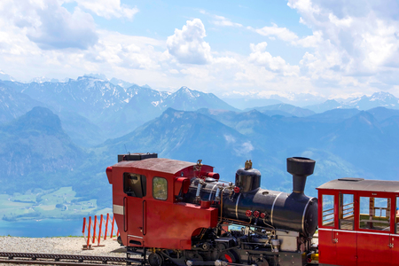 Red Traditional train on the top of European mountain, in Austria