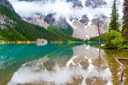 Moraine lake with fog and nountain in Banff, Alberta