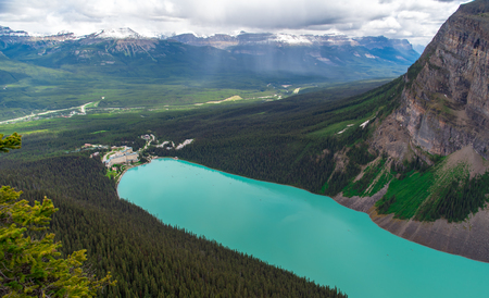 View from the top of the mountain of hotel with turquoise color at Lake Louise in Alberta, Canada