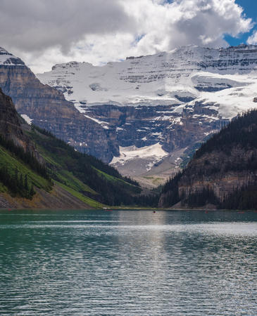 Lake Louise with mountain cover by snow on the background in sunny summer day, Alberta., Canada 写真素材