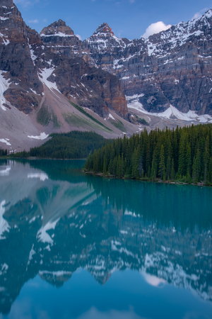 Vertical of The Moraine lake sunset with turquoise lake and bluesky, Banff, Alberta, Canada