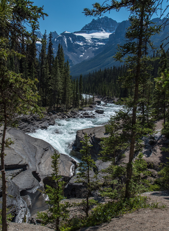 Mistaya canyon in summer beautiful blue sky in sunny day with mountain and river flowing , Alberta, Canada