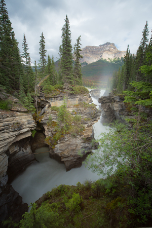 Athabasca fall with cloudy day in Spring, Alberta, Canada.