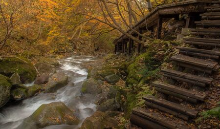 Hiking trail in Autumn , Fukushima Prefecture with waterfall , Japan