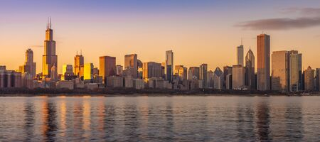 Chicago downtown skyline sunset Lake Michigan with most Iconic building from Adler Planetarium, Illinois, USA