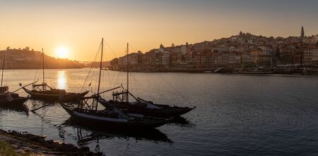 Porto cityscape in sunset with river on the front and wine carrier ship in  foreground and city of Porto in background, Portugal. 版權商用圖片