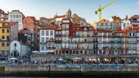 Portugal cityscape by the river with tourist (blurred face) hanging out.
