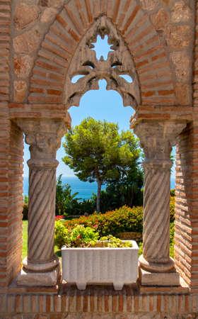 Travel sightseeing  in Spain looking throgh castle window.