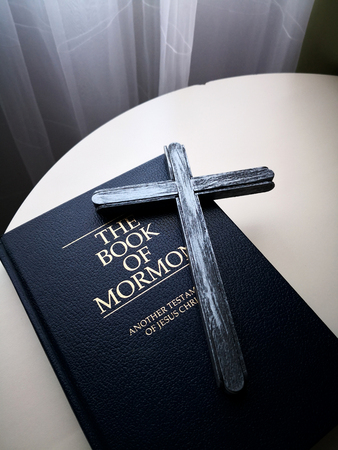 Wood cross and Holy Bible on the table