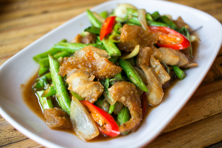belly pepper: Spicy crispy pork with long bean Stock Photo