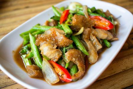 long bean: Spicy crispy pork with long bean Stock Photo