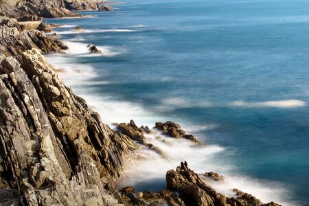 foaming: Foaming sea on the cliff Stock Photo