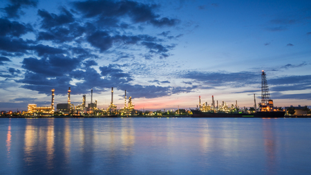 river side: river side oil refinery industry plant along twilight morning Stock Photo