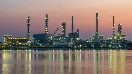 river side oil refinery industry plant along twilight morning,pink sky