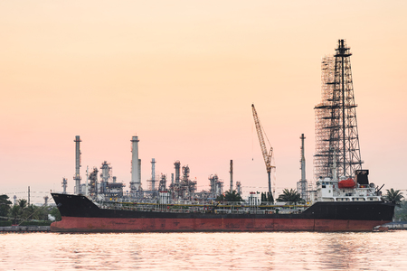 river side: river side oil refinery industry plant along twilight morning,pink sky