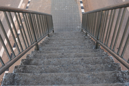 foot bridges: Old stairs of the overpass in the city