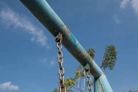 hot boy: Swing chains in a children play