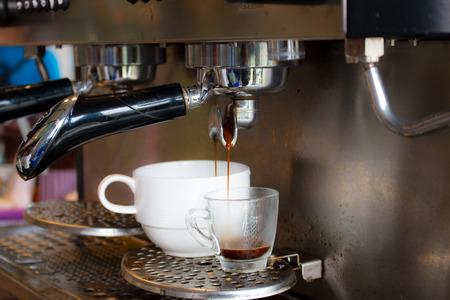 espreso: coffee machine preparing fresh coffee and pouring  in cup Stock Photo