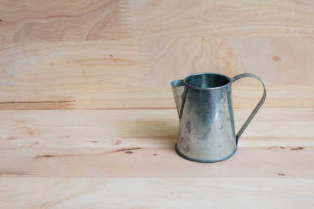 wateringcan: Watering Can miniature wooden background