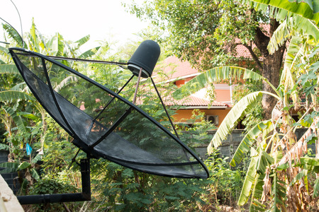satelite: satelite is attached to the wall of the house