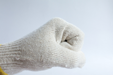 protection hands: Hand in glove, symbolic White background Stock Photo
