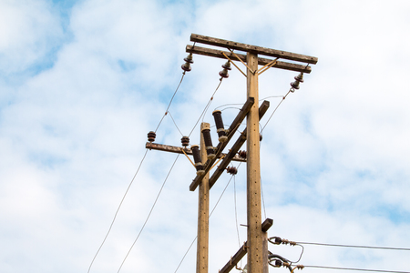 telephone poles: Chaotic mess of a wires on a pillar