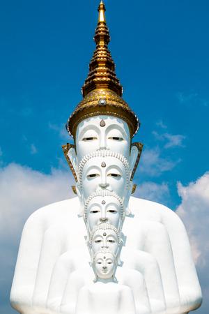 Buddha statues and colored foot path colorful glass stacked in Wat Pha Kaew, Khao Kho, Phetchabun