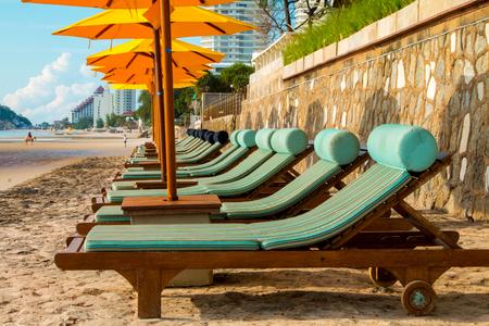 hua: chairs and umbrella on stunning tropical beach in Hua Hin Thailand Stock Photo