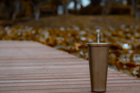 Stainless steel mug On the wood floor