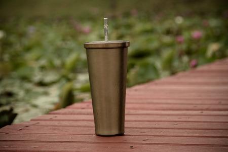 insulated: Stainless steel mug On the wood floor