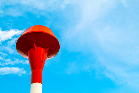 Red and white steel water tank, sky background Stock Photo