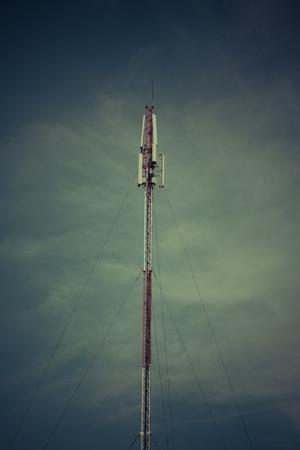 Telecom blue sky background,Phone antenna Stock Photo