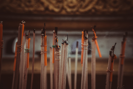 incense sticks burning in an altar at temple 版權商用圖片