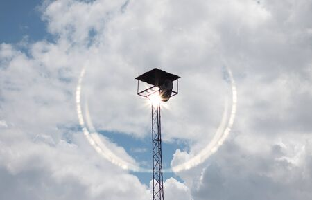 Old public loudspeakers broadcast on high tower with long distance tower Imagens