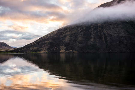 reflect: reflect of mountain between the sunrise