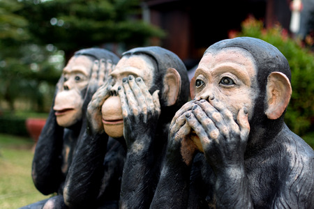 confucius: Three monkey,close up of hand small statues with the concept of see no evil, hear no evil and speak no evil. Stock Photo