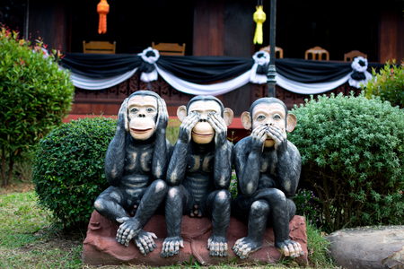 see no evil: Three monkey,close up of hand small statues with the concept of see no evil, hear no evil and speak no evil. Stock Photo