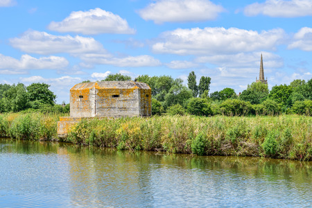 Pillbox on the banks of the River Thames Stock Photo