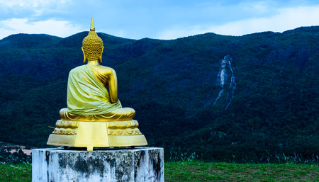 over hill: ranong buddha sculpture over hill top and ngow waterfall
