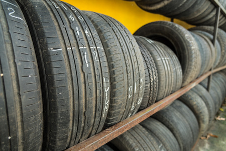secondhand: secondhand tire on yellow wall