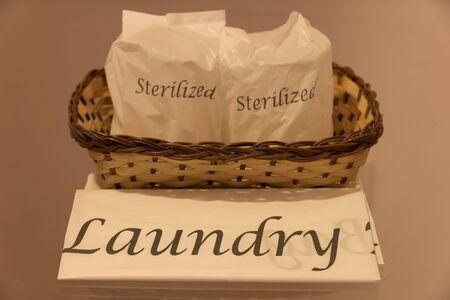 sterilized: laundry bag and sterilized glasses Stock Photo
