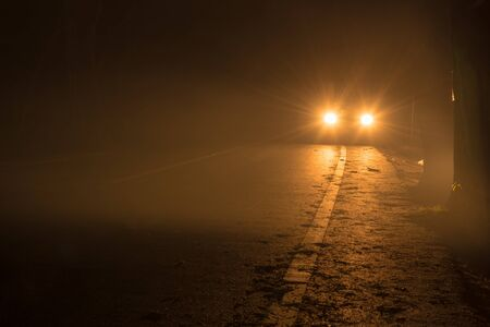 car light and road at night