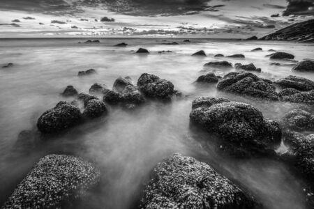 black and white smooth wave in sun set at Nai thorn Beach; Phuket ; Thailand