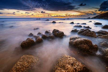 warm smooth wave in sun set at Nai thorn Beach; Phuket ; Thailand