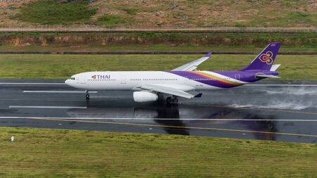 airway: Phuket, Thailand ; September 14,2558 Thai airway airplane depart at phuket airport in rainny day and runway surface wet Editorial