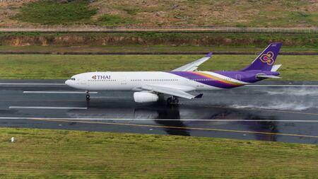 Phuket, Thailand ; September 14,2558 Thai airway airplane depart at phuket airport in rainny day and runway surface wet Sajtókép
