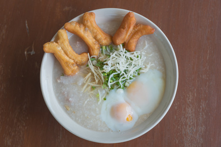 Thai style rice porridge with boiled eggs and deep-fried doughstick Stock fotó