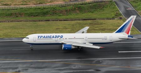 Phuket, Thailand ; September 14,2558 Trans soviet airway airplane depart at phuket airport in rainny day and runway surface wet Sajtókép
